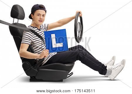 Teenage driver in a car seat showing an L-sign isolated on white background