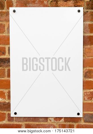 Large blank white sign on a wall ready for text.