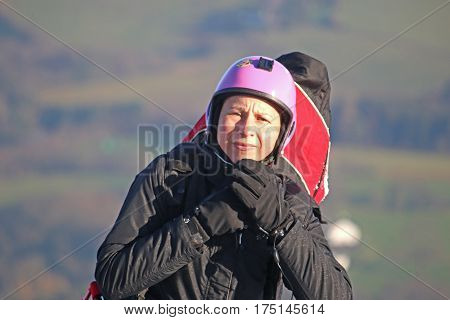 Paraglider preparing to launch her wing to fly