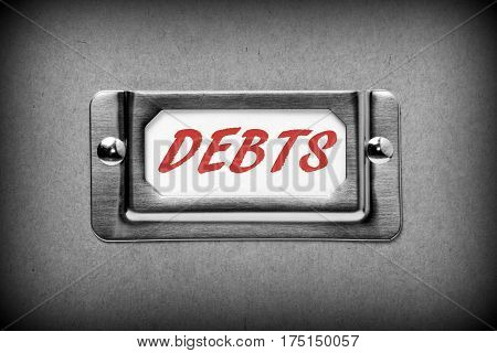 The word DEBTS in red text on a drawer label as part of filing system for storage of your finance commitments