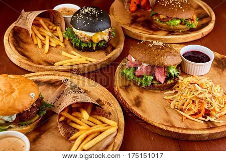Delicious hamburgers served on wooden planks. Home made hamburger.