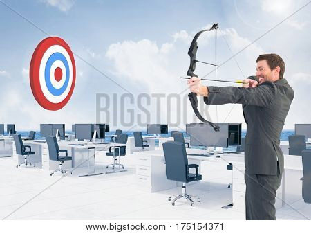 Digital composition of businessman aiming at target with bow and arrow at office