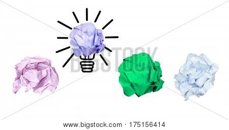 Digital composition of multi colored crumpled paper with bulb on white background