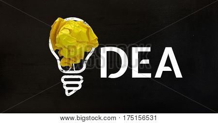 Conceptual image of bulb with crumpled paper and text on black background