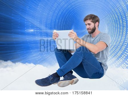 Man using laptop against digitally generated background