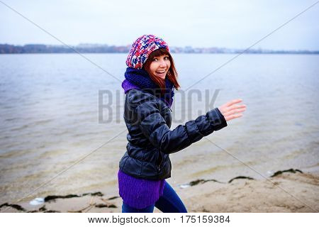 Lifestyle Portrait Of Young Caucasian Slim Woman Runs Along Beach Autumn
