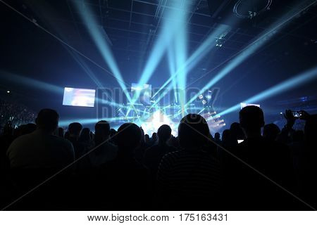 silhouettes of spectators on a concert