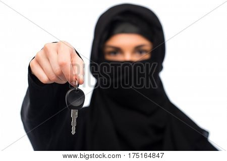 property and people concept - muslim woman in hijab with car key over white background