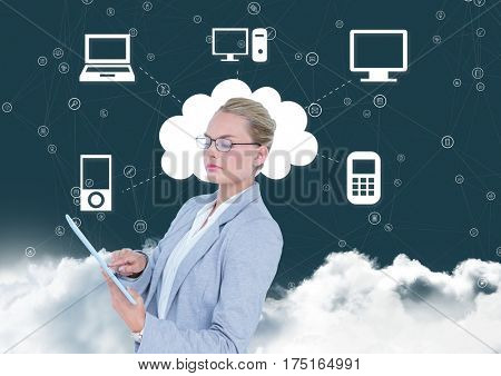 Digital composition of businesswoman using digital tablet with networking icons in background