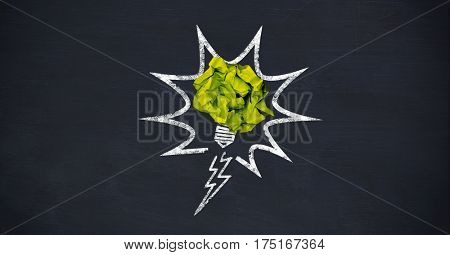 Digital composition of crumpled paper on light bulb shape against black background