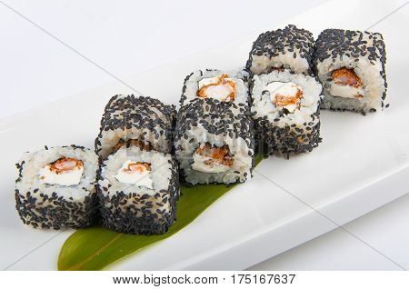 sushi roll with shrimp, Philadelphia cheese and sesame seeds