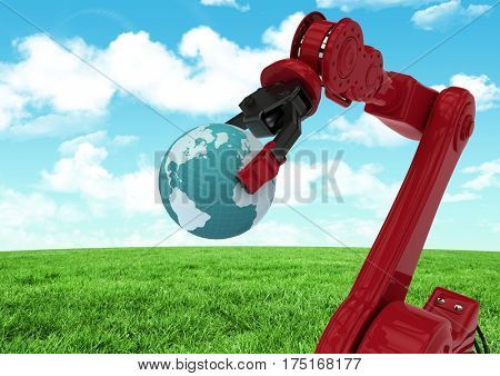 Digital composition of red robot claw holding globe against green grass field and sky