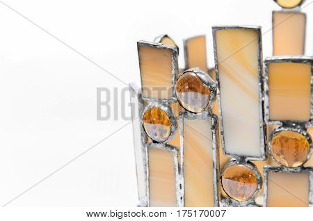 ornaments made of colored glass on white background