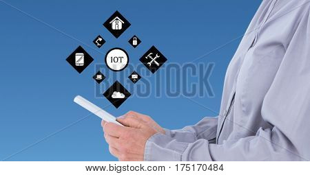 Digital composition of man using digital tablet against cloud computing concept in background
