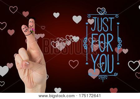 Digital composition of smiling finger couple with valentines message against red background