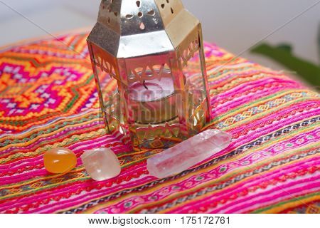 healing crystal stone and sage on a table .