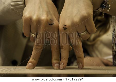 Two hands of lovers cringe at their wedding