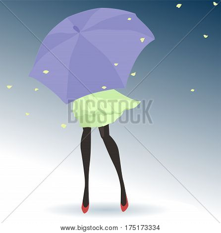Young woman hiding form the wind with an umbrella