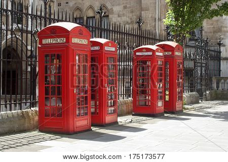 Classic London red telephone boxes in sunshine