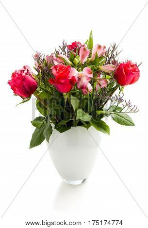 bouquet of blossoming red roses in vase isolated on white background