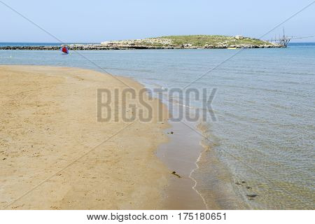 Torre Canne, Italy - 28 June 2016: beach and island on the coast of Torre Canne on Puglia, Italy