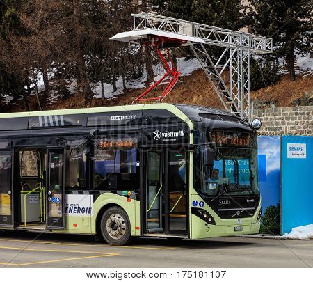 St. Moritz, Switzerland - 3 March, 2017: a Volvo 7900 Electric Hybrid bus at the quick-charge facility on Bahnhofplatz square. Buses of this type use electric power coming from their accumulators in the normal operation mode.