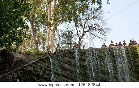 CHANDIGARH, INDIA. 31 may 2009:  The sculpture of Lord Shiva with a Trident over a man-made waterfall in a Rock Garden. Northwest of India, Chandigarh, Rock Garden.