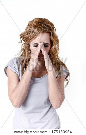 blond attractive woman on her thirties sad and depressed in sorrow and grief facial expression in female depression emotion concept isolated on white background