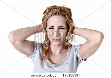 blond attractive woman on her thirties sad and depressed looking desperate in pain face expression suffering migraine and headache in depression and emotional crisis concept isolated on white