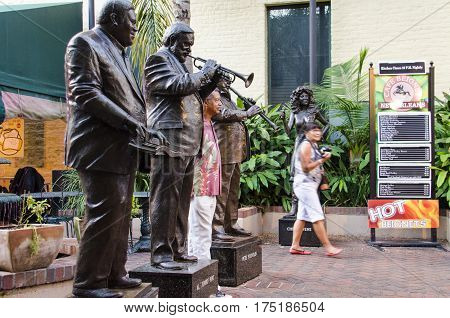 New Orleans, USA - July 8, 2015: Statues of famous jazz music players, the three Greats, Antoine