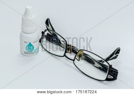 Labuan,Malaysia-Mac 3,2017:Eye Mo bottle with spectacles eyeglasses isolated on white background.Its indicated for treating eye redness & minor discomfort caused by irritants such as dust & smoke