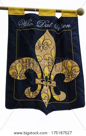 A flag with a fleur-de-lis, symbol of New Orleans, and Who Dat Nation text.