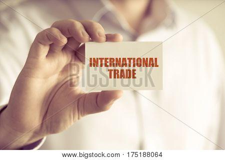 Businessman Holding International Trade Message Card