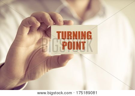 Businessman Holding Turning Point Message Card