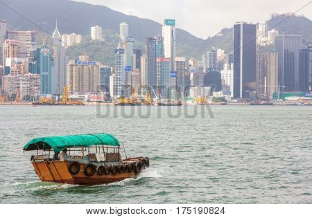 HONG KONG - May 29 2015: Traditional Boat in front of Hong Kong Harbour Skyline, May 29 2015 in Hong Kong.