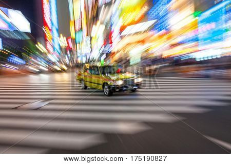 TOKYO - JUNE 6 2015: motion blurred taxi on pedestrian crossing Shibuya, Tokyo City, June 6, 2015 in Tokyo, Japan.