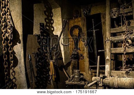 Old medieval torture chamber with many very painfull tools poster