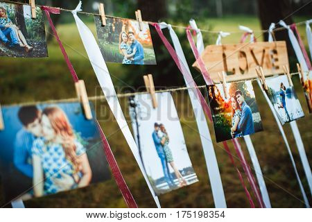 photos of lovers hanging on a rope outdoors