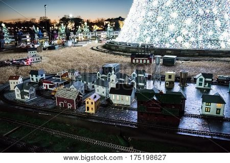 Washington DC USA - December 29 2016: National Mall Christmas tree with visitors illuminated with toy trains and houses