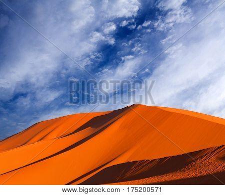 Sand dunes in Sahara desert on blue sky background in Morocco, Africa