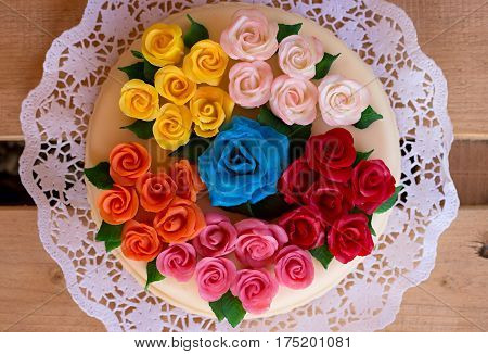 birthday cake with marzipan roses thirty-colored on a table