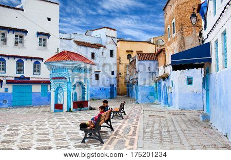 CHEFCHAOUEN, MOROCCO - JANUARY 2, 2014: Children playing at ancient square of Chefchaouen Medina