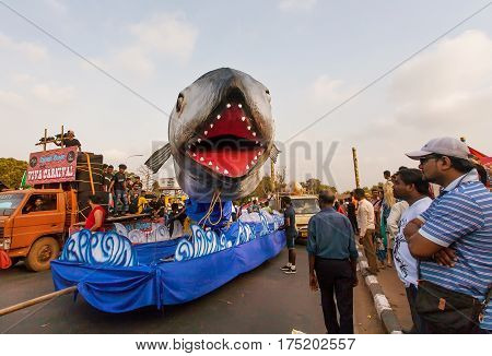 PANAJI, INDIA - FEB 25, 2017: Scary shark on a mobile platform moving in a crowd of the traditional Goa carnival on February 25, 2017. Carnaval is celebrated in Goa since 18th century