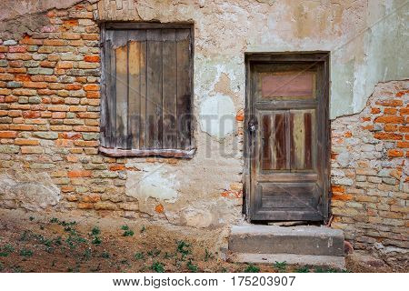 The door and window of the old brick house