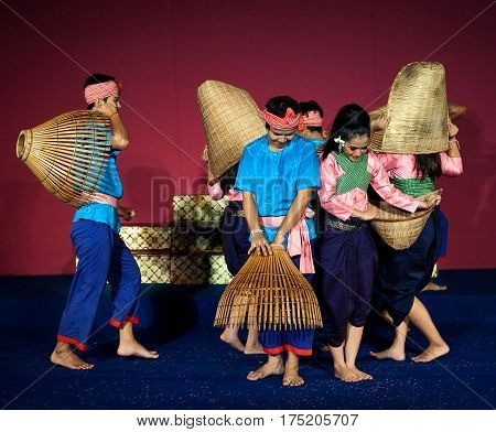 PHNOM PENH, CAMBODIA - JANUARY 10, 2013: Khmer folk dancers performing Nesat (Fishing Dance) in traditional costume.