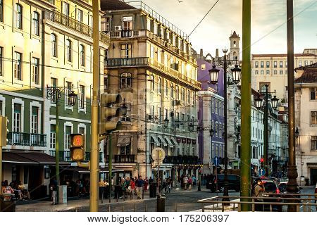 Lisbon, Portugal - Septmember 19, 2016: Street scene in the city center at Praca da Figueira - Several unidentified pedestrians on the street walking, minding their business