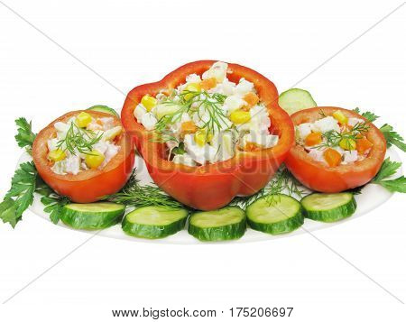 stuffed red pepper and tomato with parsley and fennel on the plate