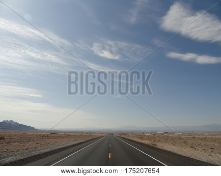 Las Vegas desert road disappearing into the horizon