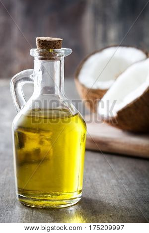 Healthy coconut fruit oil on wooden background