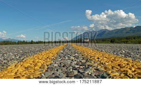 Two yellow lines on highway ground view